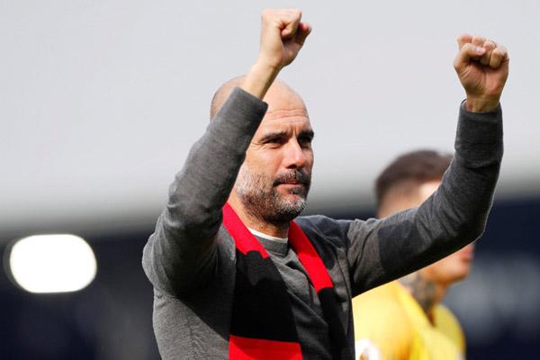 Pelatih Manchester City Pep Guardiola - Reuters/Paul Childs