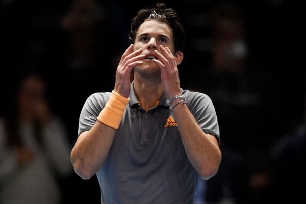 Petenis Austria Dominic Thiem setelah menundukkan Novak Djokovic (Serbia) dan merebut tiket ke semifinal ATP Finals. - Reuters