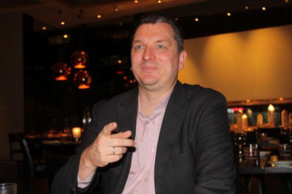 Erik Meijer, Presiden Direktur Telkomtelstra. - Bisnis.com/Akhirul Anwar
