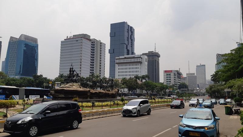 Suasana lalu lintas sekitar Monas di Jalan Merdeka Barat Jakarta seusai reuni akbar 212, Senin (2/12/2019) - Bisnis/Jaffry Prabu Prakoso