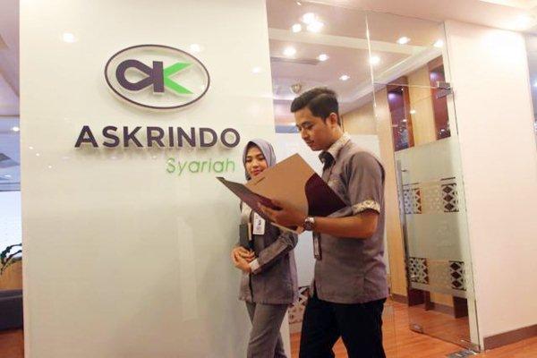 Karyawan melintas di depan logo PT Jaminan Pembiayaan Askrindo Syariah, di Jakarta, Selasa (8/1/2019). - Bisnis/Endang Muchtar