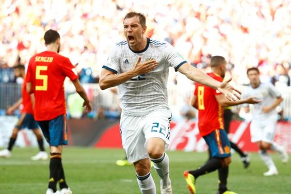 Striker Timnas Rusia Artem Dzyuba bsaat pertandingan melawan Spanyol di Piala Dunia 2018. - Reuters