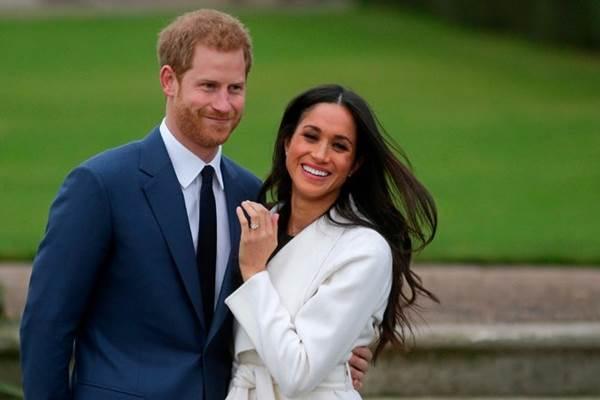 Pangeran Harry dan tunangannya Menghan Markle - nytimes