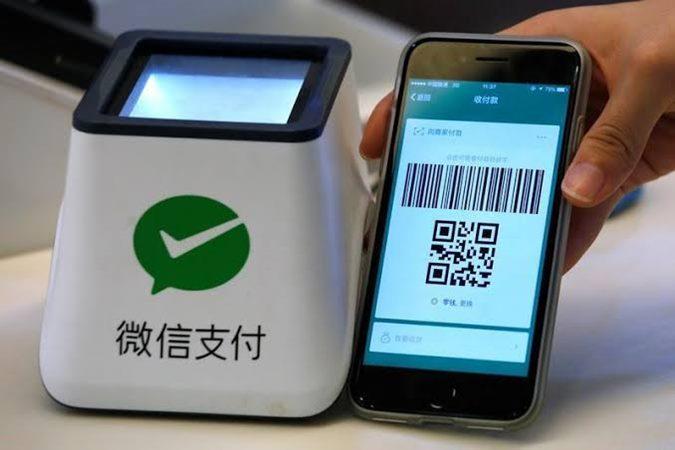 Sistem WeChat Pay ditunjukkan di kantin sebagai bagian dari kantor Tencent di dalam Zona Industri Kreativitas TIT di Guangzhou, China 9 Mei 2017. -  REUTERS / Bobby Yip