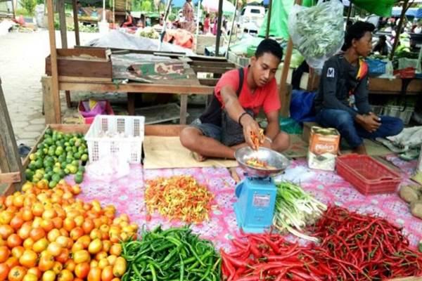 Menjelang Natal dan pergantian tahun, harga bahan pokok di pasar tradisional di Balikpapan mulai naik. - Bisnis.com/Fariz Fadhillah