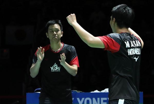 Ganda putra Hendra Setiawan (kiri) dan Mohamad Ahsan. - Badminton Indonesia