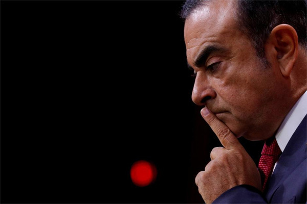 Carlos Ghosn, Ketua dan CEO Aliansi Renault-Nissan, bereaksi pada konferensi pers di Paris, Prancis, Jumat (15/9/2017). - REUTERS