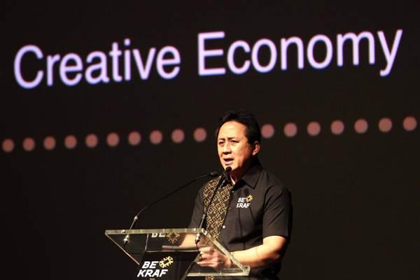 Mantan Kepala Badan Ekonomi Kreatif (Bekraf) Triawan Munaf memberikan sambutan pada Outlook Conference 2019 di Jakarta, Rabu (17/10/2018). - JIBI/Dwi Prasetya