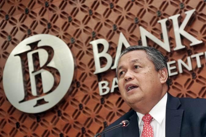 Gubernur Bank Indonesia (BI) Perry Warjiyo (dua kanan) memberikan keterangan dalam konferensi pers, di Jakarta, Kamis (20/6/2019). - Bisnis/Himawan L Nugraha