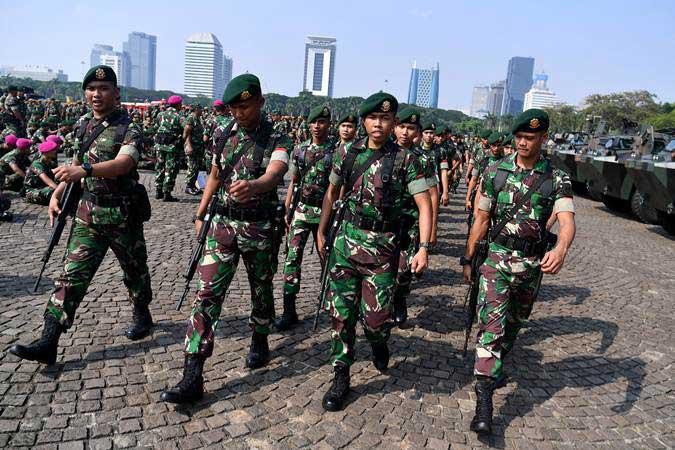 Ilustrasi - Prajurit TNI berbaris seusai mengikuti apel pengamanan di Lapangan Monas, Jakarta, Senin (20/5/2019). - ANTARA/Sigid Kurniawan