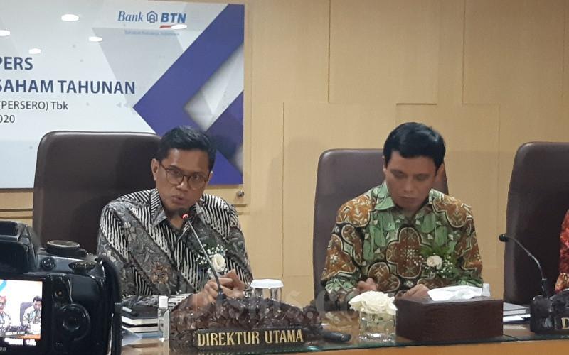 Direktur Utama BTN Pahala N. Mansury (kiri) dan Direktur Finance, Treasury and Strategy BTN Nixon L. Napitupulu (kanan) memberikan keterangan seusai RUPST di Jakarta, Kamis (12/3/2020) - Bisnis/M. Richard