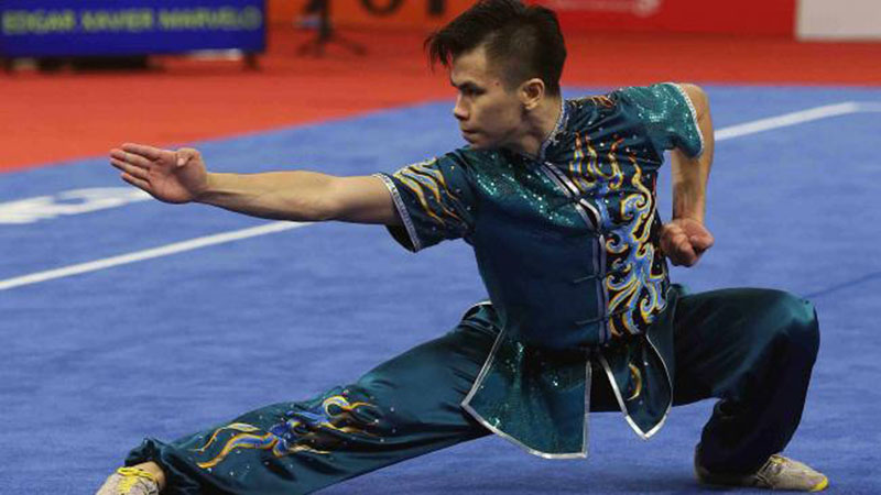 Atlet wushu Indonesia Edgar Xavier Marvelo ketika mempersembahkan medali perak di Asian Games 2018. - Antara