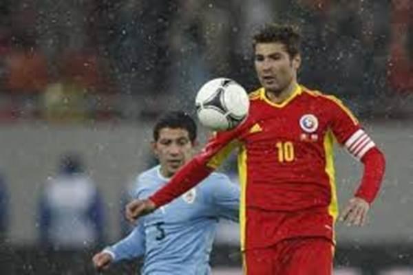 Adrian Mutu saat masih bermain dalam seragam Timnas Rumania. - Reuters