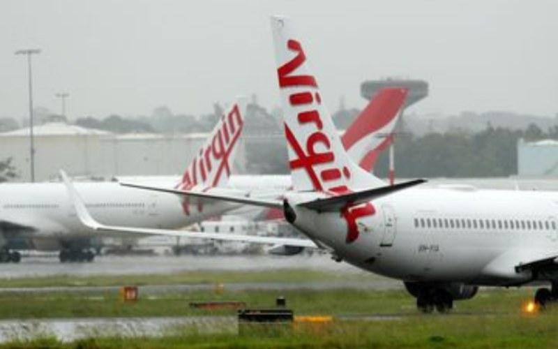 Armada Virgin Australia terparkir di Bandara Sydney. - Bloomberg