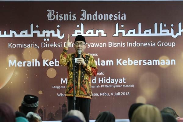 Anggota Pengawas Syariah Bank Syariah Mandiri & Khatib tetap Istana Presiden dan Wapres H. Mohamad Hidayat menyampaikan tausiah pada halal bihalal Bisnis Indonesia Group di Kantor Bisnis Indonesia, Jakarta, Rabu (4/7/2018). - JIBI/Dedi Gunawan