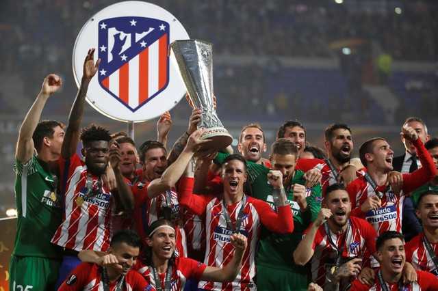 Atletico Madrid saat tampil juara Liga Europa 2 tahun lalu. - Reuters