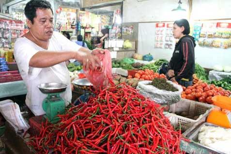 Ilustrasi pedagang cabai di pasar.