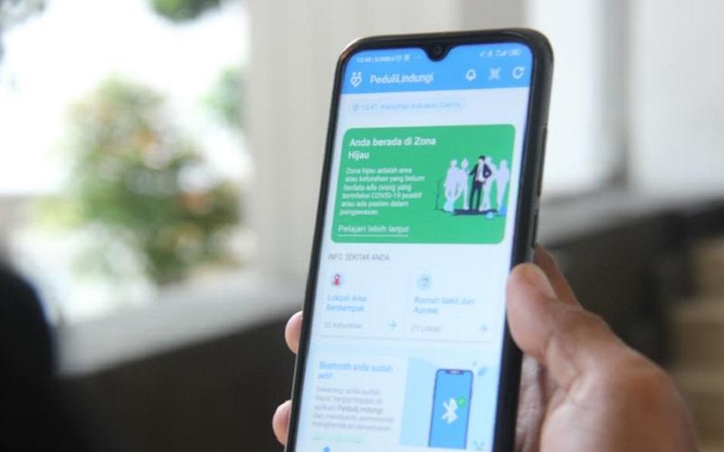 Tampilan aplikasi PeduliLindungi - Bisnis/Dea Andriyawan