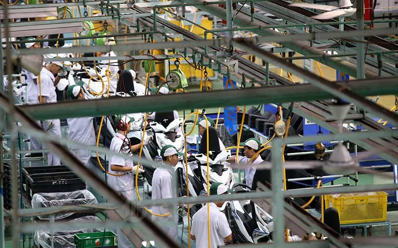 Suasana di salah satu pabrik perakitan motor di Jakarta, Rabu (1/8/2018). Bisnis - Abdullah Azzam
