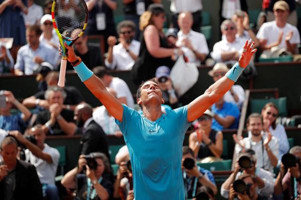 Petenis Spanyol Rafael Nadal, juara Prancis Terbuka terbanyak yaitu 12 kali, terakhir tahun lalu./Reuters - Charles Platiau