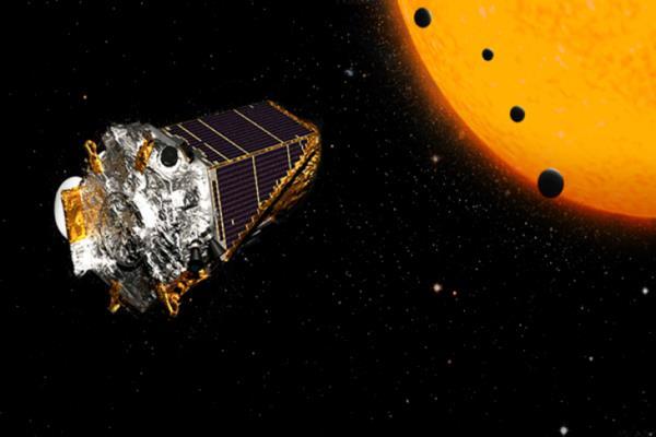 Konsep yang menggambarkan 100 lebih planet yang ditemukan Teleskop Antariksa Kepler milik NASA, termasuk empat yang seukuran Bumi. - NASA