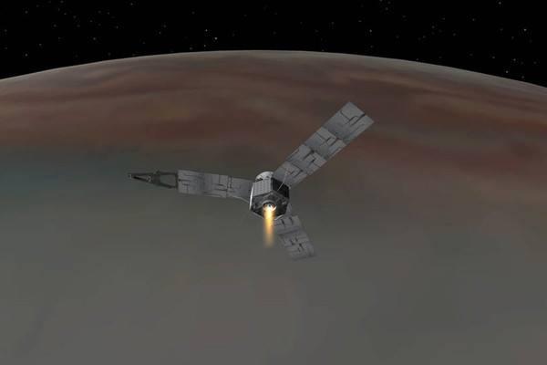 Ilustrasi yang menggambarkan pesawat antariksa Juno milik NASA memasuki orbit Jupiter - NASA
