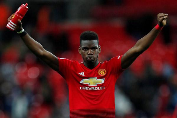 Gelandang serang Manchester United Paul Pogba. - Reuters/Eddie Keogh