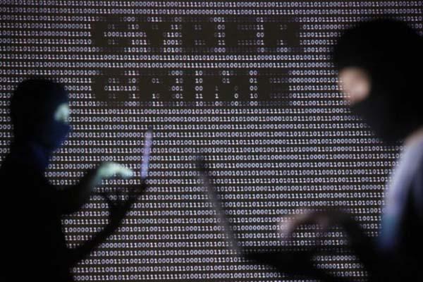 Ilustrasi kejahatan siber - Reuters/Dado Ruvic