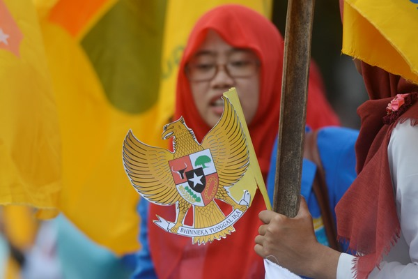 Ilustrasi - Seorang mahasiswa yang tergabung dalam Pengurus Korps Putri Pergerakan Mahasiswa Islam Indonesia (KOPRI PB PMII) melakukan aksi di Depan Istana Merdeka Jakarta, Senin (1/6). Aksi yang diikuti puluhan mahasiswa itu untuk memperingati Hari Lahir Pancasila. - Antara/Wahyu Putro A