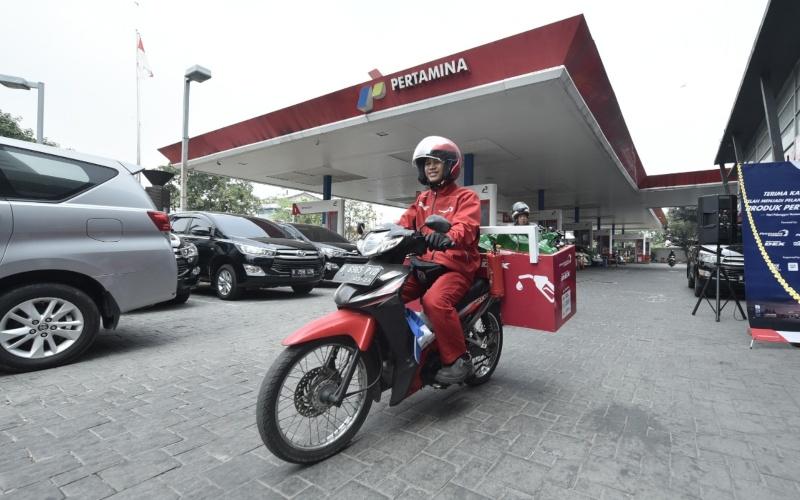 Petugas Pertamina Delivery Service (PDS) untuk pembelian produk BBM, LPG dan Pelumas. - Istimewa / Pertamina