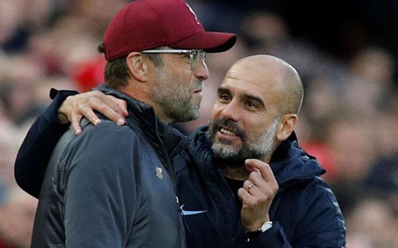 Jurgen Klopp (kiri) dan Pep Guardiola. - Reuters
