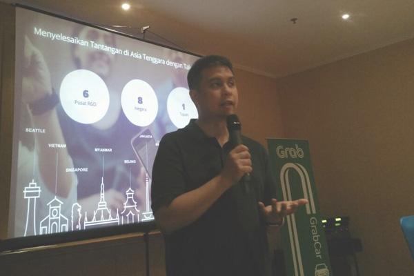 President of Grab Indonesia Ridzki Kramadibrata memberikan pemaparan saat peluncuran Grab Official Partner Asian Games 2018 di Palembang, Selasa malam (20/2/2018). Bisnis - Dinda wulandari