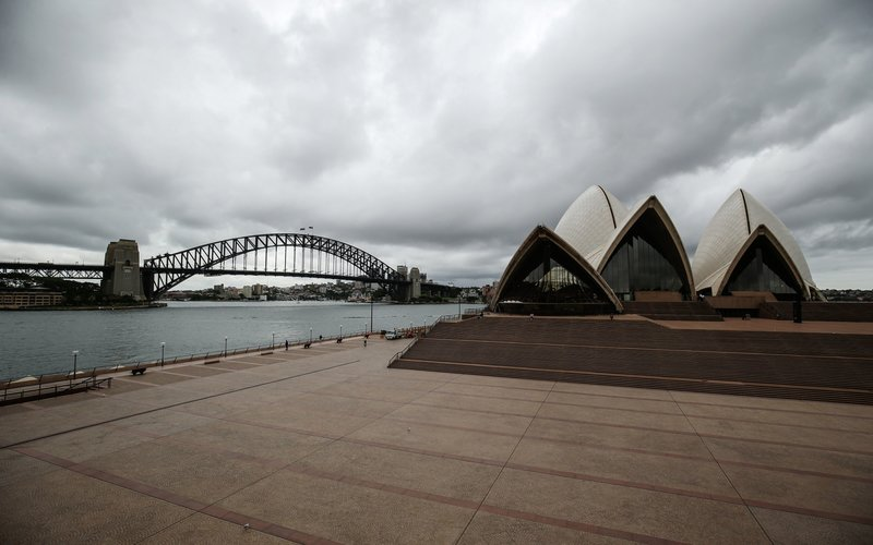 Suasana di depan Opera House, Sydney, di tengah lockdown, Senin (23/3/2020) -  Bloomberg/ Brendon Thorne