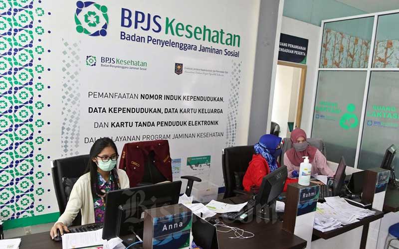 Karyawan beraktivitas di Kantor Badan Penyelenggara Jaminan Sosial (BPJS) Kesehatan. - Bisnis
