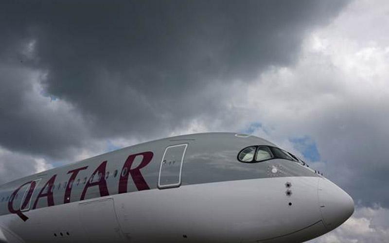 Maskapai penerbangan Qatar Airways. Di dalam pesawat, semua penumpang Qatar Airways diberikan alat perlindungan secara cuma-cuma.  - Reuters