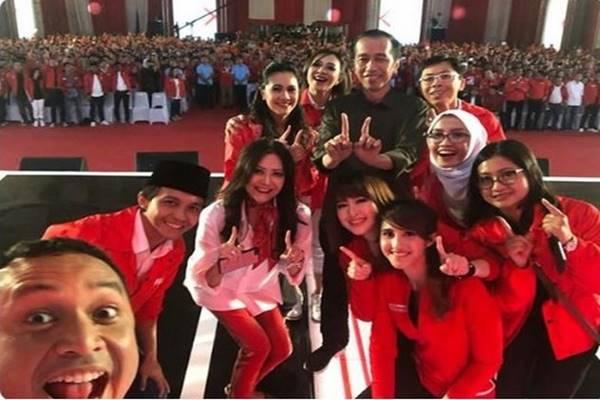 Presiden Joko Widodo menghadiri ulang tahun keempat Partai Solidaritas Indonesia (PSI) di ICE ICE BSD, Minggu (11/11). - Twitter PSI
