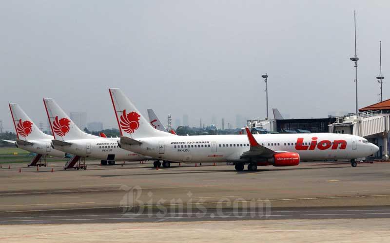 Pesawat Lion Air terparkir di Apron Bandara Soekarno-Hatta, Tangerang, Banten, Selasa (17/3/2020). Bisnis - Eusebio Chrysnamurti