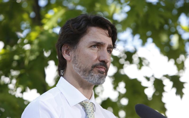 Perdana Menteri (PM) Kanada Justin Trudeau dalam sebuah konferensi pers di Chelsea, Quebec, Kanada, Jumat (19/6/2020). - Bloomberg/David Kawai