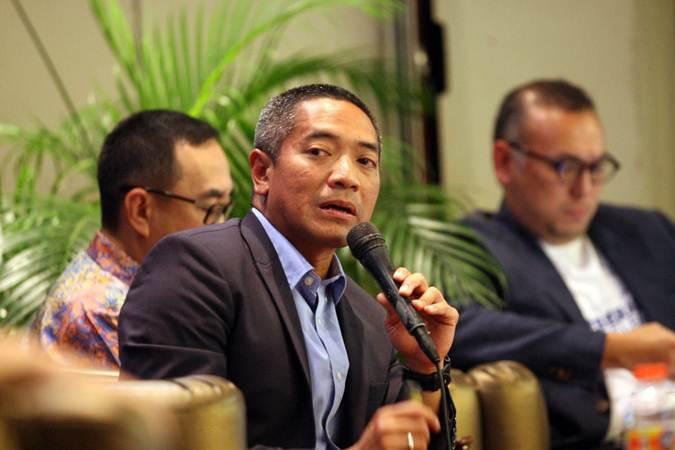 Ketua Umum Asosiasi Pendanaan Fintech Bersama Indonesia yang juga  CEO Investree Adrian A Gunadi, memberikan penjelasan pada diskusi Digital Economic Forum di Jakarta, Kamis (28/3/2019). - Bisnis/Dedi Gunawan