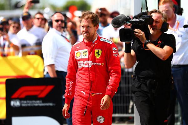 Pembalap Ferrari Sebastian Vettel seusai GP Kanada 2019. - Antara/AFP