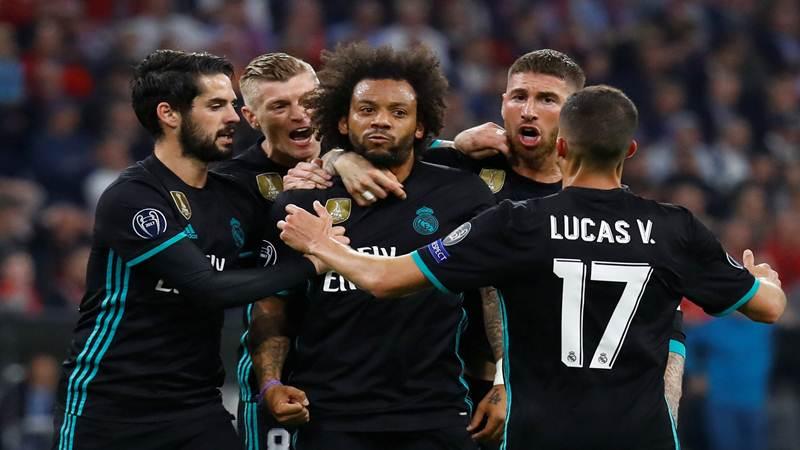 Pemain belakang Real Madrid Marcelo (tengah). - Reuters