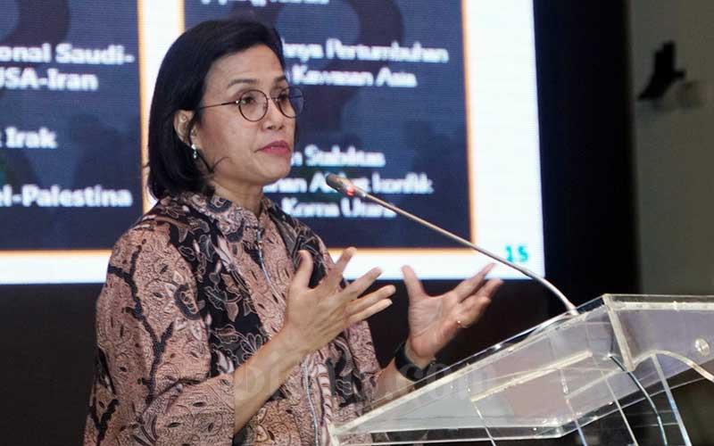 Menteri Keuangan Sri Mulyani Indrawati memberikan pemaparan dalam seminar Indonesia Economic & Investment Outlook 2020 di Jakarta, Senin (17/2/2020). Bisnis - Himawan L Nugraha
