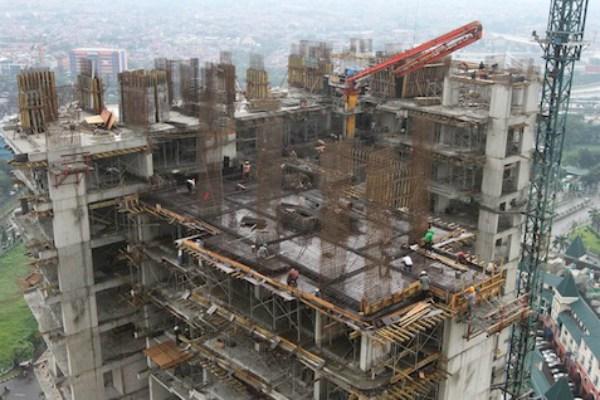 Pembangunan apartemen milik salah satu pengembang. - Ilustrasi