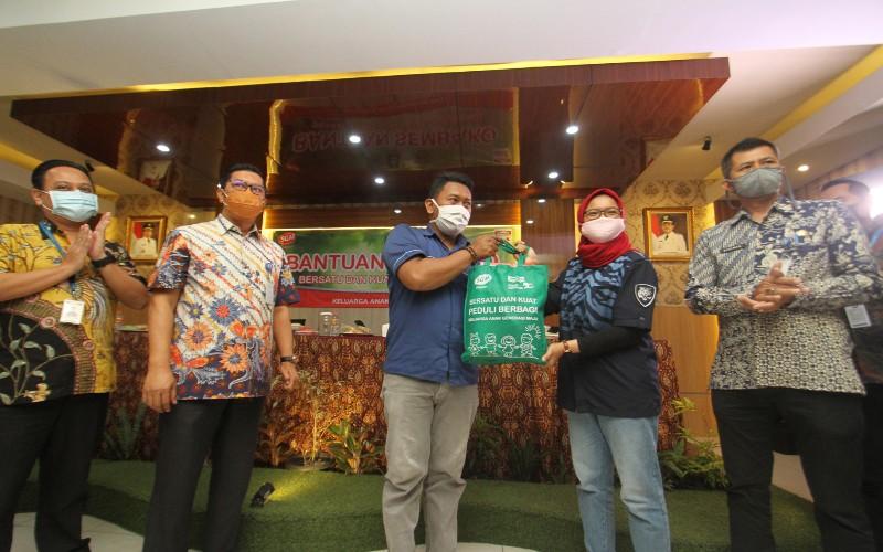 SGM Eksplor dan Indomaret Salurkan Bantuan Senilai Rp 1 Miliar