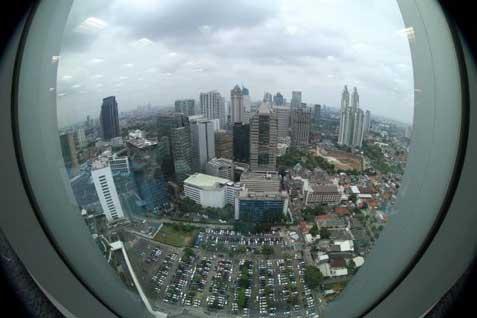 Pemandangan gedung perkantoran di Jakarta. - Bisnis