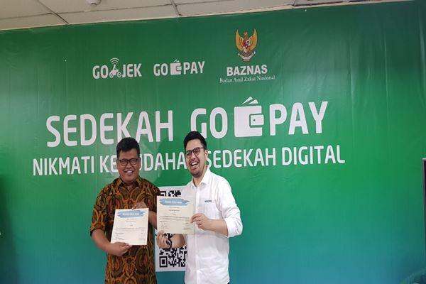 Go-Pay bekerja sama dengan Badan Amil Zakat Nasional untuk mempermudah masyarakat melakukan pembayaran zakat.-JIBI - Nuriman Jayabuana