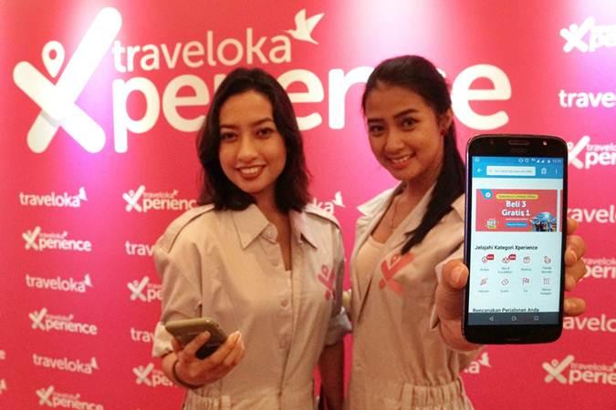 Model menunjukkan produk baru Traveloka di sela-sela konferensi pers, di Jakarta, Kamis (20/6/2019). - Bisnis/Himawan L Nugraha