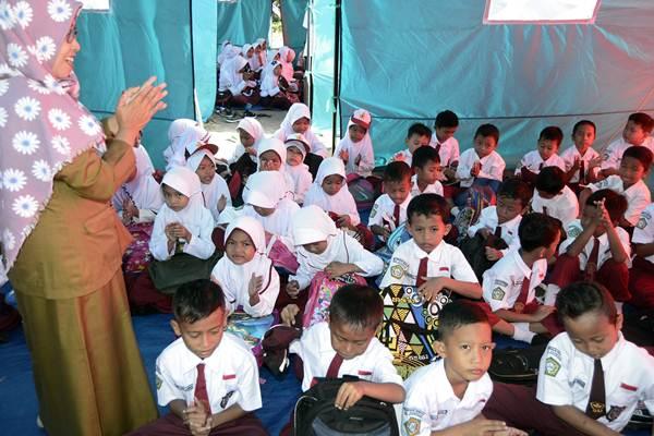 Ilustrasi kegiatan madrasah sebagai langkah awal penanaman pemahaman moderasi dalam beragama./Antara - Ardiansyah