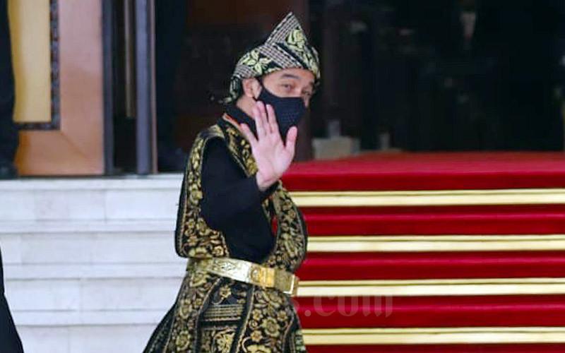 Presiden Joko Widodo saat tiba di Ruang Rapat Paripurna I, Kompleks Parlemen, Jakarta, Jumat (14/8/2020). Bisnis - Arief Hermawan P