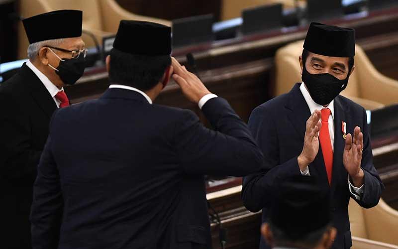 Presiden Joko Widodo didampingi Wakil Presiden Ma'ruf Amin tiba di lokasipembukaan masa persidangan I DPR tahun 2020-2021 di Kompleks Parlemen, Senayan, Jakarta, Jumat (14/8/2020)./Antara - Akbar Nugroho Gumay
